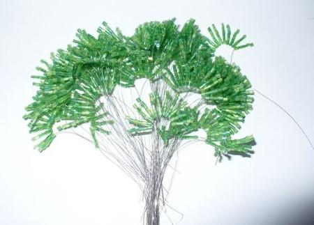Фотография из каталогов: Схемы вязания крючком с мехом и Вязание двумя спицами , Виды плетения из бисера.